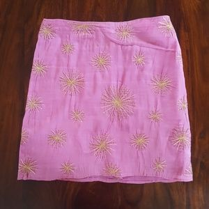 Pink skirt with metallic gold stitched flowers